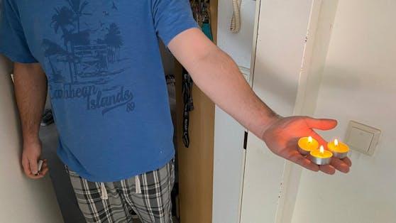 Ein Nachbar der Familie hat drei Kerzen für die Kinder angezündet.