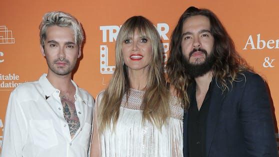 """Zornige """"Tokio Hotel""""-Fans fragen sich, ob Heidi Klum bald zum """"fünften Bandmitglied"""" wird."""
