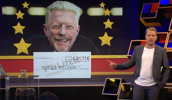 """Unter dem Motto """"Make Boris rich again"""" sammelte Oliver Pocher für Boris Becker. In einer Scherz-Aktion überreichte der TV-Comedian dem Tennis-Ass auch eine gefälschte Auszeichnung."""