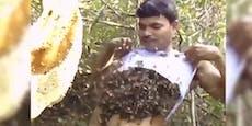 Er stopft sich ein Bienenvolk ins Shirt