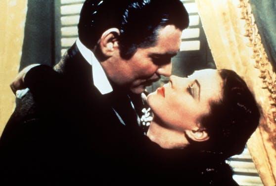 Vom Winde verweht:  Scarlett O'Hara (Vivien Leigh) und Rhett Butler (Clark Gable) bei einem der legendärsten Filmküsse der Kino-Geschichte