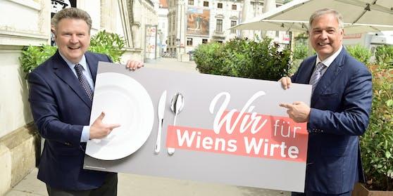 Bürgermeister Michael Ludwig und WK Wien-Präsident Walter Ruck bei der Präsentation des Gastro-Gutscheins an.