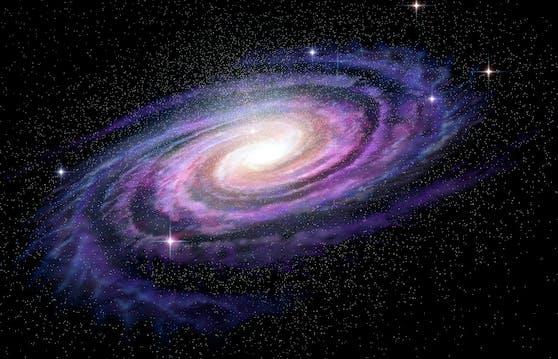 Eine Galaxie beweist, dass auch im Weltraum der Schein trügen kann. Hinter ihrem harmlosen Äußeren verbirgt sich ein kannibalistischer Wesenszug.
