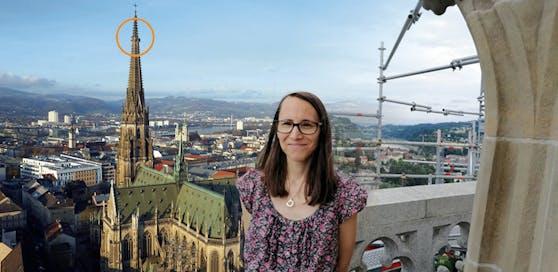 """Heute""-Reporterin Claudia Ruzmarinovic in 112 Metern Höhe am Linzer Mariendom."