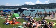Menschen genießen Hitze im vollen Freibad