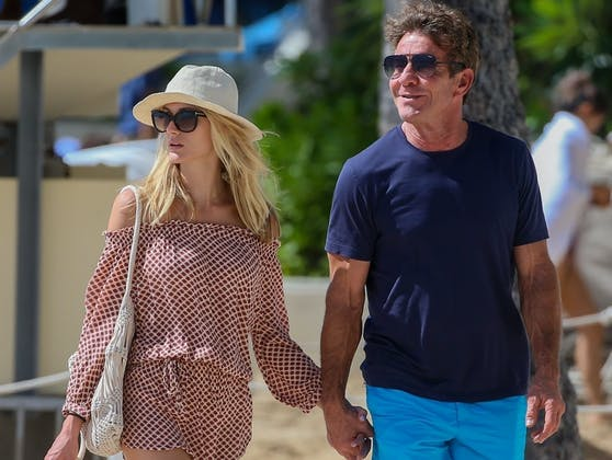 Der schwarze Kater wird das Familienleben von Hollywood-Star Dennis Quaid (re.) und seine Frau Laura Savoie bereichern.