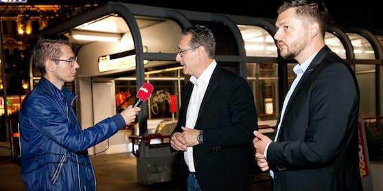 """Heinz-Christian Strache und Zoran Kovacevic am Reumannplatz im Gespräch mit Clemens Oistric (""""Heute"""")"""