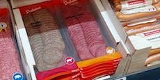 Supermarkt verkauft abgepackte, graue Gammelwurst