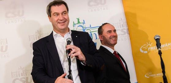Markus Söder (CSU) und Hubert Aiwanger (Freie Wähler) einigten sich auf eine gemeinsame Regierungsbildung in Bayern.