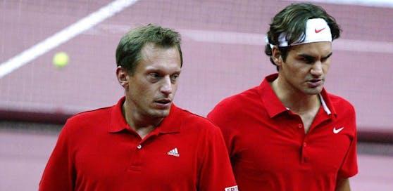 Yves Allegro (li.) mit Roger Federer (r.)
