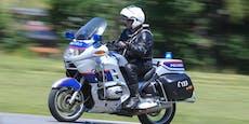 Polizist auf Motorrad von Lkw erfasst, schwer verletzt
