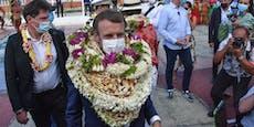 Frankreichs Präsident Macron geht in Blumenmeer unter