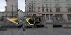 Was macht riesige goldene Scheibe in der Wiener City?