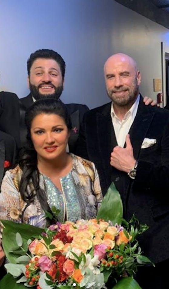 Anna Netrebko mit Ehemann Yusif Eyvazov und John Travolta