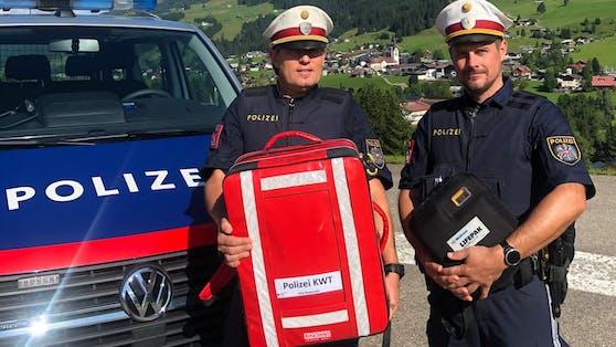 Die beiden Polizei-Helden Michael Schwärzler und Andreas Amann retteten einem 49-Jährigen am Mittwoch per Defibrilator das Leben.