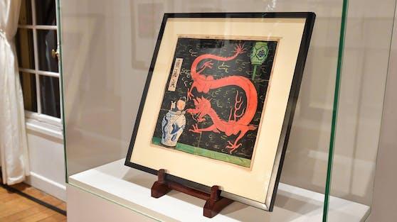 """Die Titel-Illustration des """"Tim und Struppi""""-Abenteuers """"Der Blaue Lotos"""" von Hergé gilt als wertvollstes Comic-Cover."""