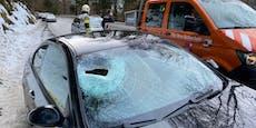 Felsbrocken durchschlägt Autoscheibe und trifft Frau