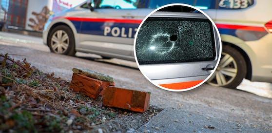 Bei einem Fahrzeug wurde ein Loch in die Seitenscheibe geschlagen.