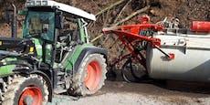 Traktor-Crash überflutet Straße mit Gülle