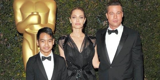 Damals noch eine glückliche Familie: Maddox, Angelina Jolie und Brad Pitt im Jahr 2013 auf dem Roten Teppich.
