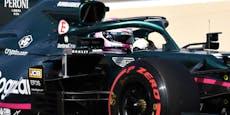 Vettel im Training von Auto-Teil am Helm getroffen