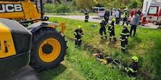 Lenker wurde unter Rasenmäher-Traktor eingeklemmt